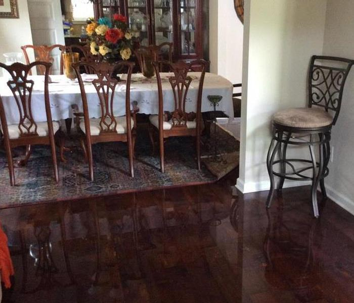 Water saturated hardwood floors in several rooms