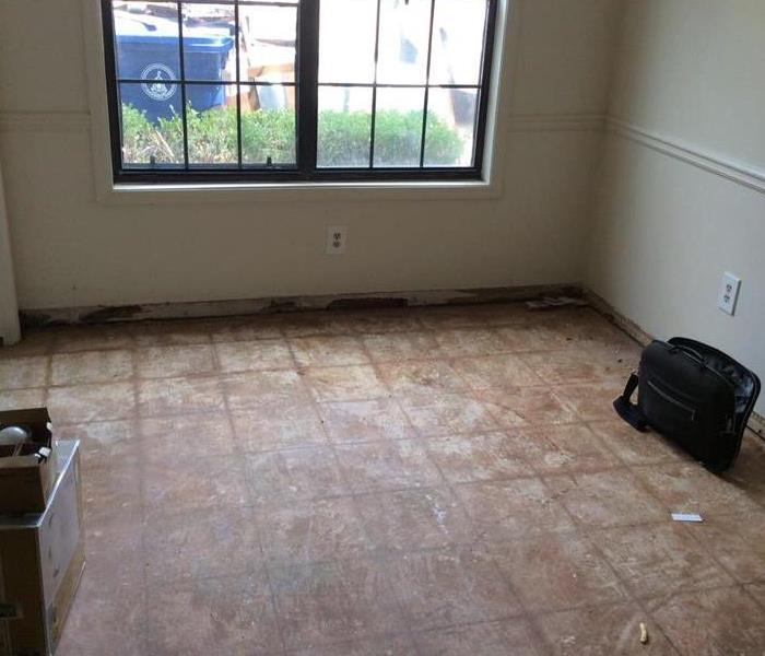 Wet walls and floor in kitchen area.