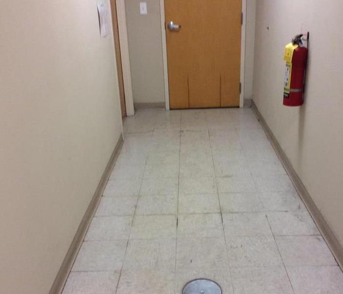 Wet hallway and door in commercial building