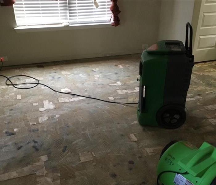 Hardwood floors removed and equipment placed in Dining Room
