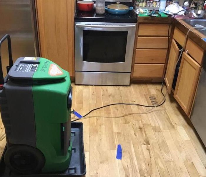 Equipment placed in kitchen due to water leak under sink
