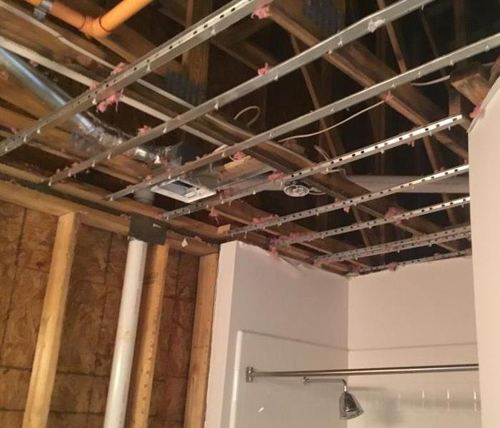 Removal of bathroom ceiling due to broken pipe in breezeway attic.