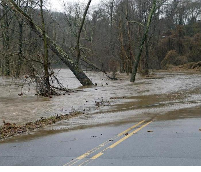 Dangers of Flash Flood Conditions - image of flash flood on road
